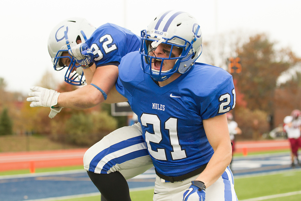 Carl Lipani and Ben Zurkow, of Colby College, celebrate Lipani's first quarter touchdown in a NCAA Division III football game against Bates College on October 26, 2013 in Waterville, ME. (Dustin Satloff/Colby College Athletics)