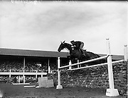 05/08/1960<br /> 05/08/1960<br /> 05 August 1960<br /> R.D.S Horse Show Dublin (Friday). Aga Khan Trophy. Lieut-Col. Carlos Delia (Argentina) on &quot;Huipil&quot;, clears the stone wall on his 2nd round, to give Argentina victory in the Aga Khan Jumping Competition at the Dublin Horse Show.