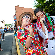 """Taylor Rodriguez works the crowd at Crusin'  Downtown Bedford car show in downtown Bedford.  """"It doesn't matter if they're a little five-year-old kid of an 80 year-old-woman.  It's always a hug for them or a lei for their neck or a kiss on the cheek,"""" said Rodriguez's second cousin Vicki Joyce."""