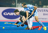 BHUBANESWAR  (INDIA)  - HERO Champions Trophy Hockey men. Day 1. Germany vs India.  Ramandeep Singh of India and Moritz Polk (l)  PHOTO  KOEN SUYK