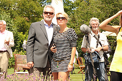 ROGER TAYLOR and    at a luncheon hosted by Cartier for their sponsorship of the Style et Luxe part of the Goodwood Festival of Speed at Goodwood House, West Sussex on 4th July 2010.