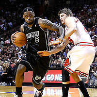 29 January 2012: Miami Heat small forward LeBron James (6) drives past Chicago Bulls shooting guard Kyle Korver (26) during the Miami Heat 97-93 victory over the Chicago Bulls at the AmericanAirlines Arena, Miami, Florida, USA.