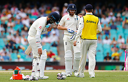 England's Jonny Bairstow changes his gloves during day five of the Ashes Test match at Sydney Cricket Ground.