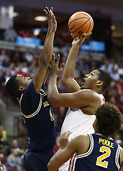 December 4, 2017 - Columbus, OH, USA - Ohio State Buckeyes forward Kaleb Wesson (34) shoots over Michigan Wolverines guard Muhammad-Ali Abdur-Rahkman (12) during the second half on Monday, Dec. 4, 2017, at Value Center Arena in Columbus, Ohio. (Credit Image: © Fred Squillante/TNS via ZUMA Wire)