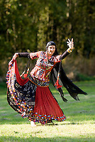 A dancer performs a Gypsy dance during the First Nations cultural celebration held in the Comox Valley, from the Rhazastan region of Northern India.  Courtenay, Vancouver Island, British Columbia, Canada.