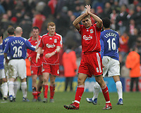 Photo: Paul Thomas.<br /> Liverpool v Everton. The Barclays Premiership. 03/02/2007.<br /> <br /> Dejected Liverpool captain Steven Gerrard thanks the Kop End after the game.