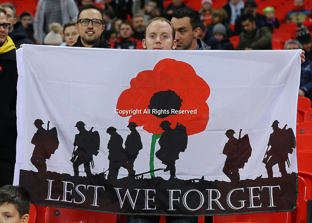11.11.2016. Wembley Stadium, London, England. World Cup Qualifying Football. England versus Scotland. A fan Remembers with a poppy banner