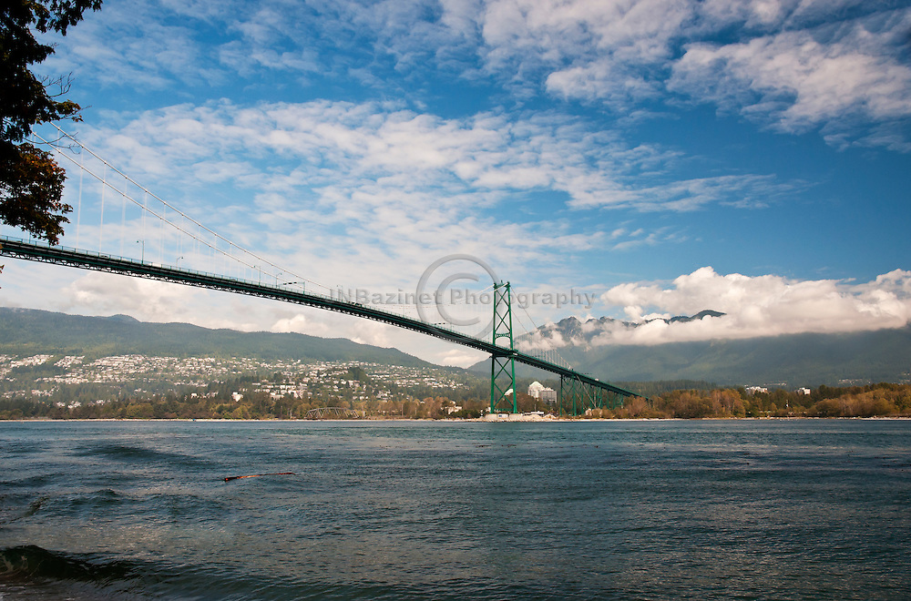 The Lions Gate Bridge connects Stanley Park to the North Shore of Vancouver.  The total length of the bridge including the north viaduct is 1,823 metres (5,890 feet).  the tower height is 111 m (364 ft), and it has a ship's clearance of 61 m (200 ft).