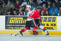 KELOWNA, CANADA - APRIL 8: Ryan Hughes #19 of the Portland Winterhawks checks Cal Foote #25 of the Kelowna Rockets into the boards on April 8, 2017 at Prospera Place in Kelowna, British Columbia, Canada.  (Photo by Marissa Baecker/Shoot the Breeze)  *** Local Caption ***