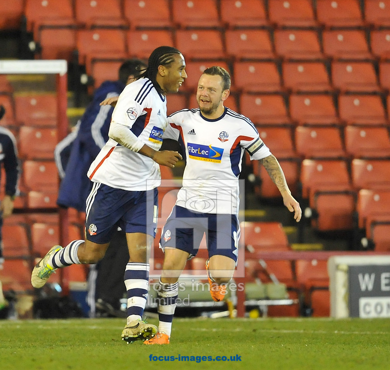 Picture by Richard Land/Focus Images Ltd +44 7713 507003<br /> 26/12/2013<br /> Neil Danns of Bolton Wanderers (18) celebrates making it 1-0 during the Sky Bet Championship match at Oakwell, Barnsley.