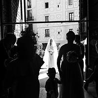 The bride waits at the entrance to the Santa Maria del Mar church in El Borne barrio of Barcelona, Catalunya.