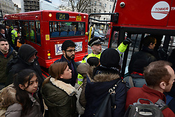 Tube Strike. Police officers help the commuters at King's Cross Station. King's Cross Station, London, United Kingdom. Wednesday, 5th February 2014. Picture by Peter Kollanyi / i-Images