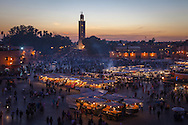 Djemaa El Fna Square in the medina of Marrakesh at dusk. The square is a Unesco World Heritage site. http://www.gettyimages.com/detail/photo/bright-lights-big-city-royalty-free-image/481202103
