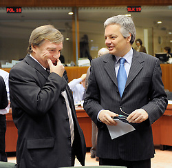 Jeannot Krecke, Luxembourg's minister of economy and foreign trade, left, speaks with Didier Reynders, Belgium's finance minister, during ECOFIN, the meeting of EU economic and finance ministers, in Brussels, Belgium, Tuesday, Dec. 2, 2008. (Photo © Jock Fistick)