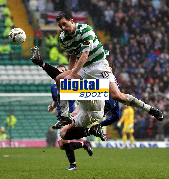 Photo: Paul Thomas.<br /> Glasgow Celtic v Glasgow Rangers. Bank of Scotland Scottish Premier League. 11/03/2007.<br /> <br /> Jan Vennegoor (Hoops) of Celtic is challenged by Charlie Adam in the air.