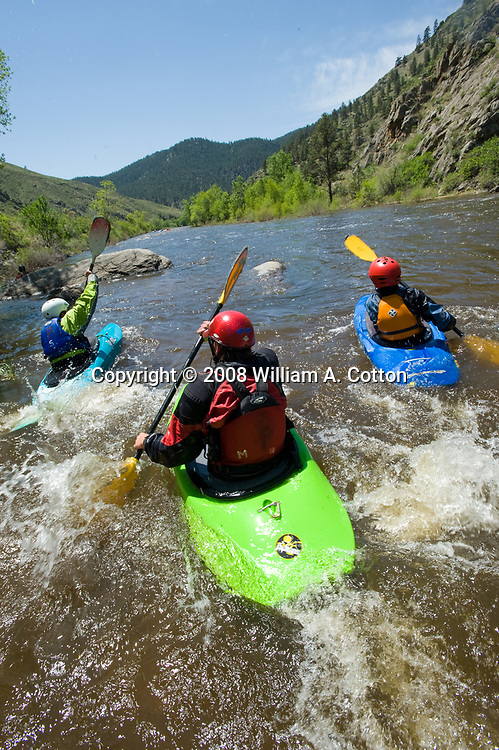 Kayakers enjoy a day on the Cache la Poudre River west of Fort Collins, Colorado.