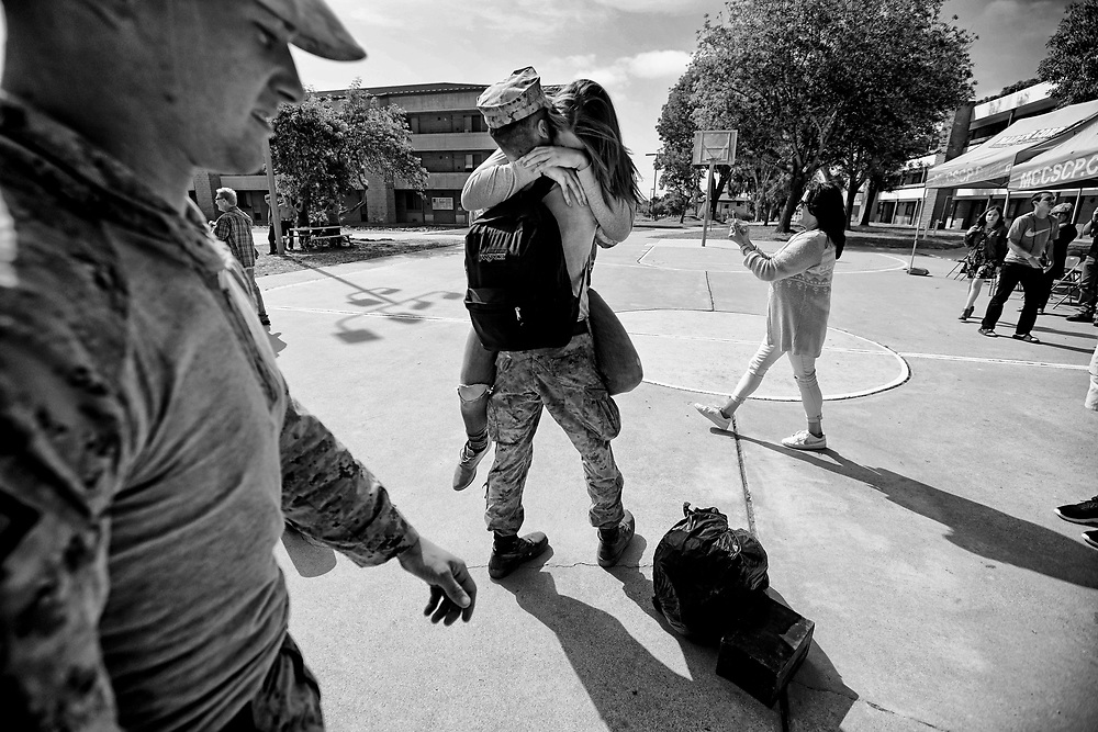 Katie Sciutto hugsher boyfrined Cpl. Seth Peaton during a homecoming reception at Camp Pendleton on Thursday, May 11, 2017 in Oceanside, California.   Marines and sailors from the 11th Marine Expeditionary Unit returned to Camp Pendleton after serving seven months in the Western Pacific, Middle East, and Horn of Africa.