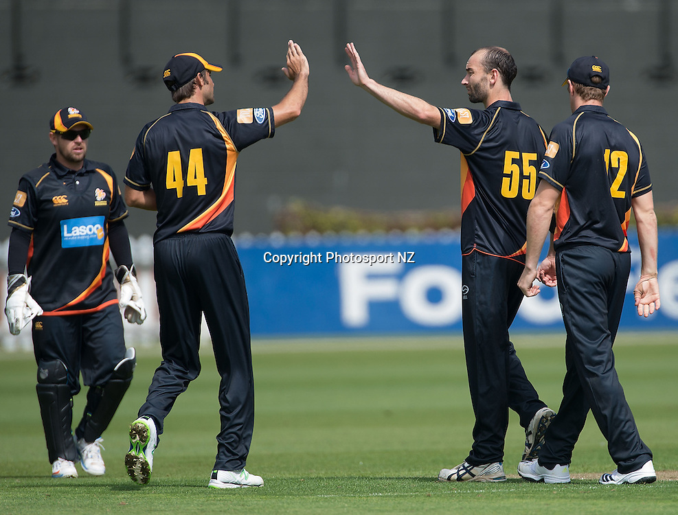 Wellington celebrates Andrew Mathieson of CD being caught out during the Ford Trophy One Day cricket match between the Wellington Firebirds and Central Districts at the Basin Reserve in Wellington on Sunday the 23rd March 2014.  Photo by Marty Melville/Photosport.co.nz