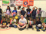 Kevin McGrath, founder of @AdoptAGym, donates new athletic equipment to students at MacGregor Elementary School.