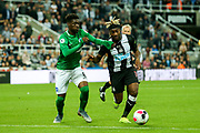 Allan Saint-Maximin (#10) of Newcastle United takes on Yves Bissouma (#8) of Brighton & Hove Albion during the Premier League match between Newcastle United and Brighton and Hove Albion at St. James's Park, Newcastle, England on 21 September 2019.