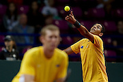 Nick Kyrgios from Australia in action while men's double during the BNP Paribas Davis Cup 2013 between Poland and Australia at Torwar Hall in Warsaw on September 14, 2013.<br /> <br /> Poland, Warsaw, September 14, 2013<br /> <br /> Picture also available in RAW (NEF) or TIFF format on special request.<br /> <br /> For editorial use only. Any commercial or promotional use requires permission.<br /> <br /> Photo by &copy; Adam Nurkiewicz / Mediasport
