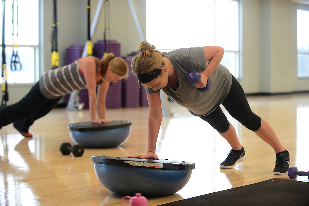 Two students work out in the Student Recreation and Wellness Center