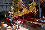 An artisan paints the intricate royal chariot that will carry the late His Majesty King Bhumibol Adulyadej to the cremation grounds for the Royal Cremation Ceremony.<br /> <br /> The area around the Royal Palace in Bangkok is busy in preparation for the ceremony that will take place between 25-29 October 2017. It will be the final tribute and farewell to the revered King who died on the 13 October 2016 aged 89.