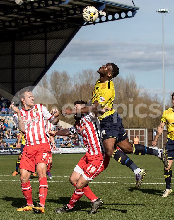 Cheyenne Dunkley of Oxford United and Dean Wells of Stevenage during the Sky Bet League 2 match between Oxford United and Stevenage at the Kassam Stadium, Oxford, England on the 25th March 2016. Photo by Liam McAvoy.