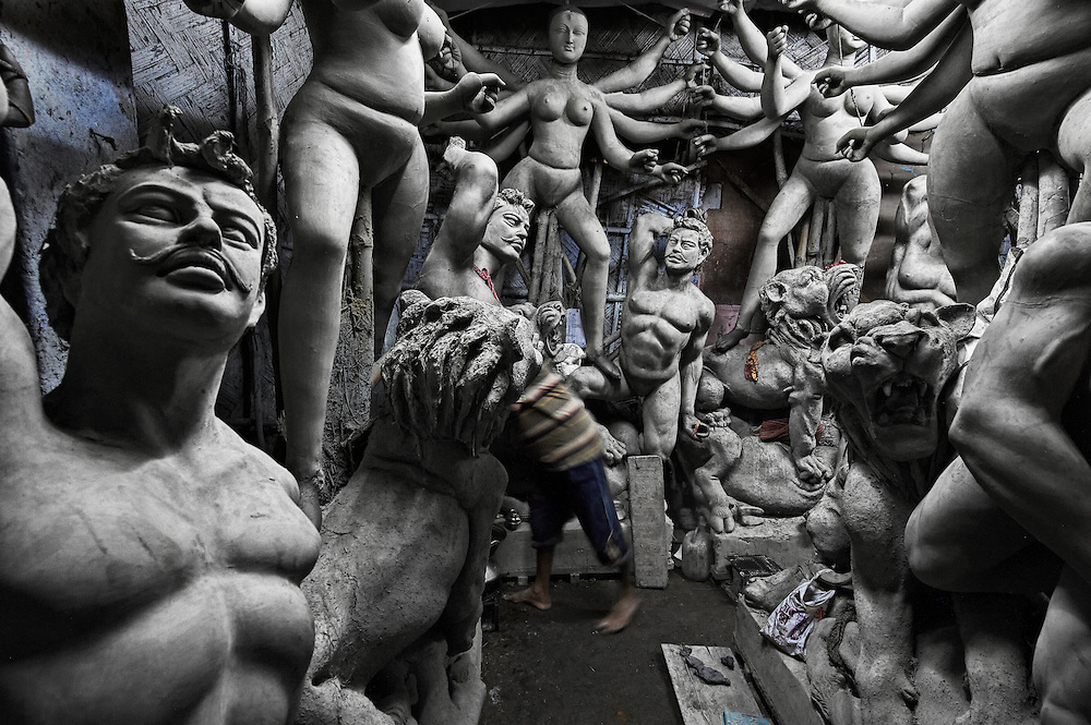 A potter inside his idol factory in Kumartuli, Kolkata.