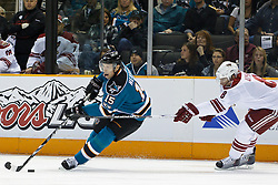 February 1, 2011; San Jose, CA, USA; San Jose Sharks right wing Dany Heatley (15) skates with the puck past Phoenix Coyotes right wing Scottie Upshall (8) during the first period at HP Pavilion. San Jose defeated Phoenix 5-3. Mandatory Credit: Jason O. Watson / US PRESSWIRE