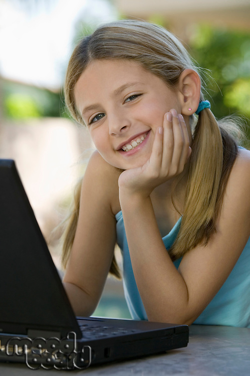 Girl Using Laptop on Patio