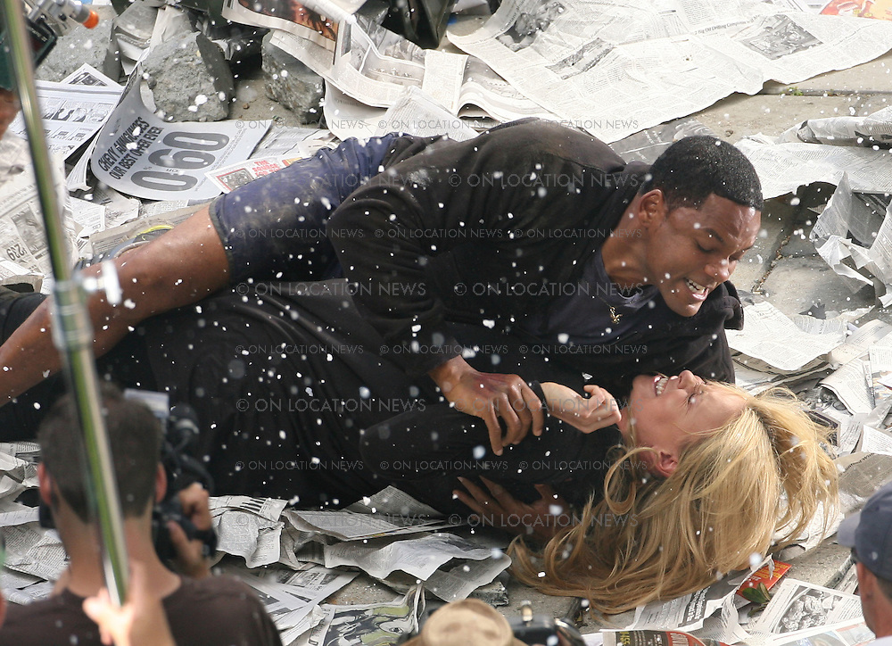 """Los Angeles, CALIFORNIA - Saturday 11th August 2007. NON EXCLUSIVE: Charlize Theron and Will Smith film a very physical as well as emotional scene. In the scene Superhero Will has just crashed landed from flying with Charlize against her will. After landing the two wrestle and fight as Charlize keeps yelling """"I hate you"""" to and she and begins to cry. In the movie these two fall in love. Photograph: Buchan/Ford/On location News. Sales: Eric Ford 1/818-613-3955 info@OnLocationNews.com"""
