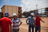 ITUMBIARA, BRAZIL - OCTOBER 16:<br /> Workers at one of Cargill's plants near the city of Itumbiara, in Goias state, Brazil, on Wednesday, Oct. 16, 2013. Since the US recently passed a number of regulations and standards for cars and dropped tariffs that were in place for decades against Brazilian sugar, Brazilian ethanol is now flowing to the U.S., and the ethanol industry in the country is consolidating and ramping up for a new era.
