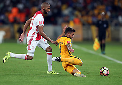 Daniel Cardoso of Kaizer Chiefs looks to get the ball away from Nathan Paulse of Ajax Cape Town during the 2016 Premier Soccer League match between Kaizer Chiefs and Ajax Cape Town held at the Moses Mabhida Stadium in Durban, South Africa on the 24th September 2016<br /> <br /> Photo by:   Steve Haag / Real Time Images
