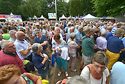 Nederland, Nijmegen, 17-7-2016Inschrijving voor de 100e vierdaagse. Op de Wedren schrijven lopers zich in voor de tocht die dinsdag begint .30, 40 en 50 km. 49.000 deelnemers hebben zich aangemeld. Ze krijgen een polsbandje met een barcode die de controle op het parcours makkelijker maakt. The International Four Day Marches Nijmegen, or Vierdaagse, is the largest marching event in the world. It is organized every year in Nijmegen mid-July as a means of promoting sport and exercise. Participants walk 30, 40 or 50 kilometers daily, and on completion, receive a royally approved medal, Vierdaagsekruisje. The participants are mostly civilians, but there are also a few thousand military participants. The maximum number of 45,000 registrations has been reached. More than a hundred countries have been represented in the Marches over the years. FOTO: FLIP FRANSSEN