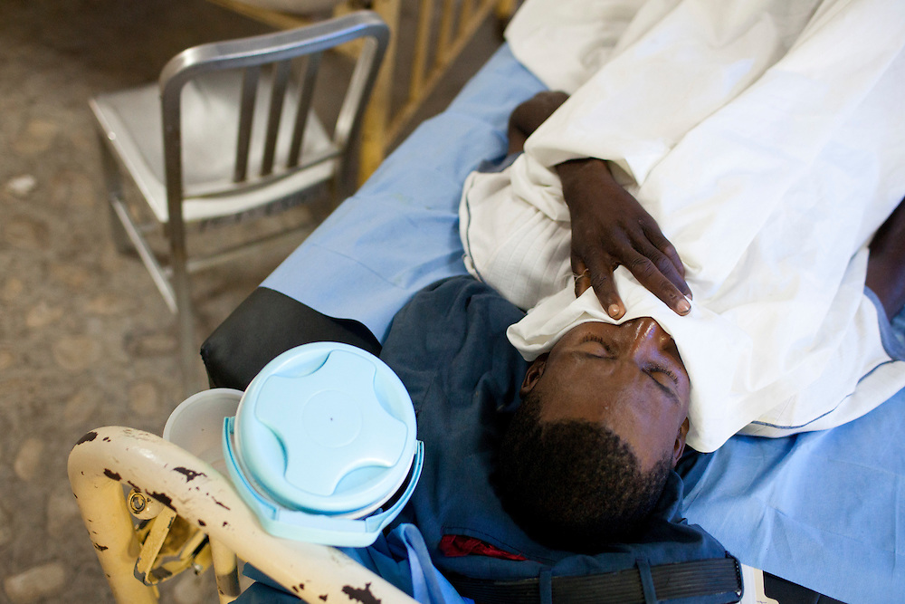 A man with cholera sleeps at the Hospital Albert Schweitzer on Friday, October 29, 2010 in Deschapelles, Haiti.