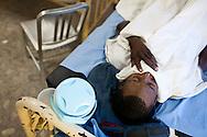 A man with cholera sleeps at the Hospital Albert Schweitzer on Friday, October 29, 2010 in Deschapelles, Haiti.