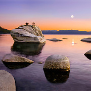 Bonsai Rock and the full moon at sunset at Lake Tahoe