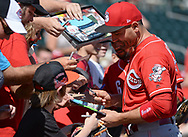 MESA, AZ - MARCH 09:  Joey Votto #19 of the Cincinnati Reds signs autographs for fans prior to the spring training game against the Oakland Athletics at HoHoKam Stadium on March 9, 2017 in Mesa, Arizona.  (Photo by Jennifer Stewart/Getty Images)