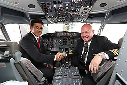 CARDIFF, WALES - Saturday, June 4, 2016: Wales' manager Chris Coleman with flight captain Steve Hunt in the cockpit as the team depart from Cardiff Airport heading to Sweden for their last friendly before the UEFA Euro 2016 in France. (Pic by David Rawcliffe/Propaganda)