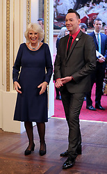 December 23, 2017 - London, London, United Kingdom - Image licensed to i-Images Picture Agency. 22/12/2017. London, United Kingdom. The Duchess of Cornwall, President of the National Osteoporosis Society, is greeted by Strictly Come Dancing judge Craig Revel Horwood as she arrives at Buckingham Palace in London to host a tea dance attended by 'Strictly Come Dancing' dancers and judges to highlight the benefits for older people of staying active. (Credit Image: © Rota/i-Images via ZUMA Press)