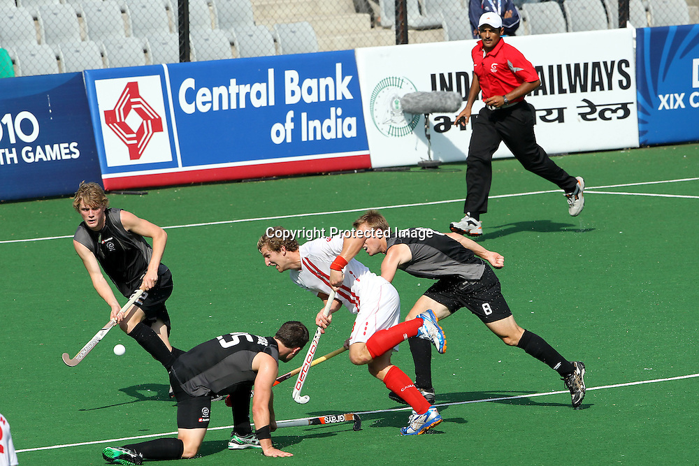 Mark Pearson attacks for Canada during the hockey match between New Zealand and Canada during the XiX Commonwealth Games  held at the MDC Stadium in New Delhi, India on the  10 October 2010<br /> <br /> Photo by:  Ron Gaunt/photosport.co.nz