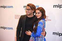 Kem Cetinay, Amber Davies poses as arriving for the opening ceremony of the MIPCOM in Cannes - Marche international des contenus audiovisuels du 16-19 Octobre 2017, Palais des Festivals, Cannes, France.<br />