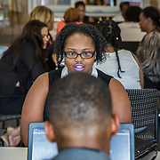 WASHINGTON, DC -JUL23: Ishia Davis, 22, a student at Potomac State College, works with a success coach at the Department of Employment Services, during a workshop for 22-24 year old participants in DC's Student Youth Employment Program, SYEP, at the Department of Employment Services in Northeast, Washington, DC, July 23, 2015. (Photo by Evelyn Hockstein/For The Washington Post)