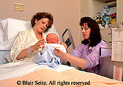 Medical, Nurse and Mother with Baby in Hospital Maternity Room