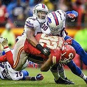Buffalo Bills defensive end Jerry Hughes (55) was hit by his own teammate, Buffalo Bills strong safety Bacarri Rambo (30) as the two tackled Kansas City Chiefs running back Spencer Ware (32) in the fourth quarter on Sunday, November 29, 2015 at Arrowhead Stadium in Kansas City, Mo. The Chiefs won, 30-22.