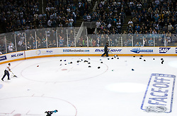 October 8, 2009; San Jose, CA, USA; Members of the San Jose Sharks staff shovels hats thrown on the ice after right wing Dany Heatley (not pictured) scored a hat trick during the third period against the Columbus Blue Jackets at HP Pavilion. San Jose won 6-3. Mandatory Credit: Jason O. Watson / US PRESSWIRE