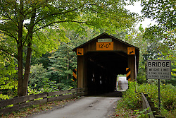 Built in 1873, this 115-foot-long covered bridge spans the Ashtabula River in Plymouth Township, Ohio.
