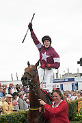 30/07/2014 Noel Meade owned horse Road to Riches Trained by  Eddie O&rsquo;Leary with Jockey Shane Shortall celebrating as he is applauded in to the winners enclosure <br />  .Photo:Andrew Downes