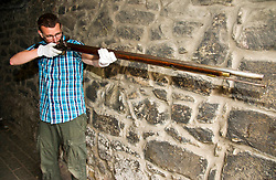 Pictured: Curator Nico Tyack takes aim with an 18th century musket<br /> <br /> The latest Museum of Edinburgh exhibition documents the history of Edinburgh's Town Guard, which brought law and order to the city in the 18th century. Curator Nico Tyack and Museum Assistant David Mclay examined muskets, halberds and drums before the exhibition was opened to the public<br /> <br /> Ger Harley | EEm 15 June 2017
